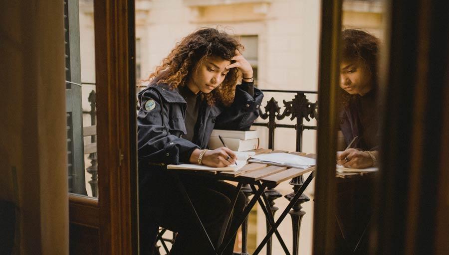 Woman studying on blacony
