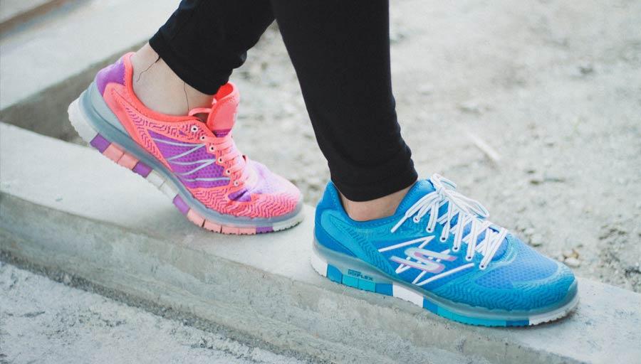 Woman wearing odd trainers